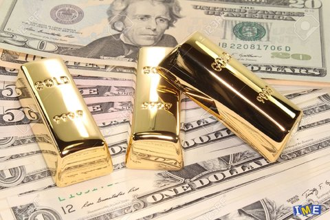 9970404-three-large-gold-bars-at-many-dollar-bills-Stock-Photo.jpg